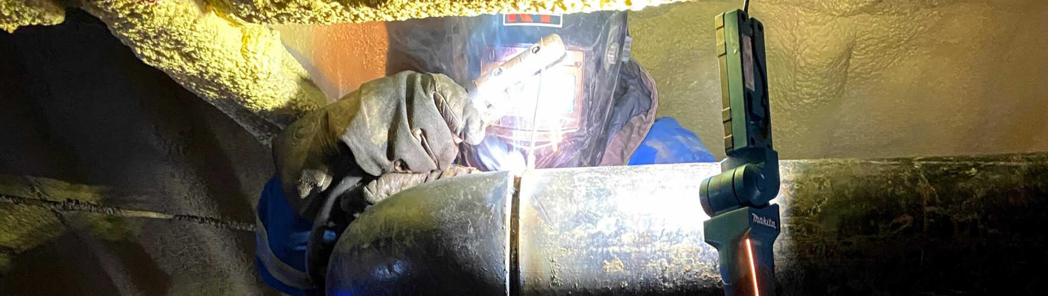 Man welding, banner